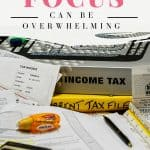 desk full of bills and taxes to pay