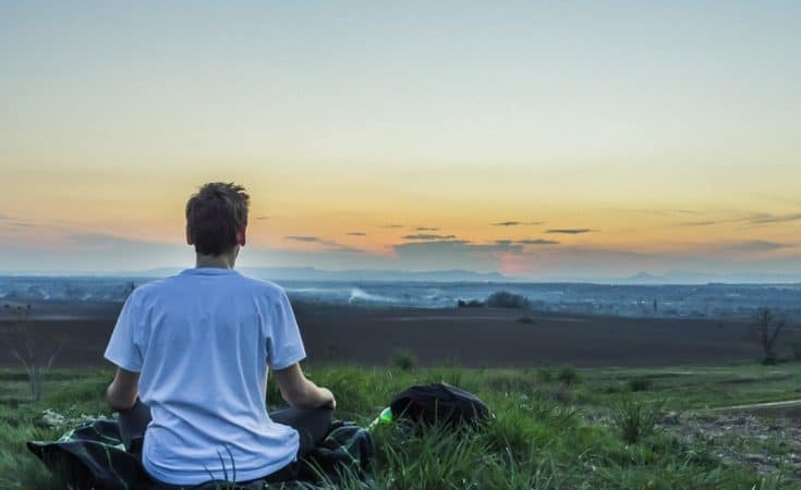 Person meditating for self-care
